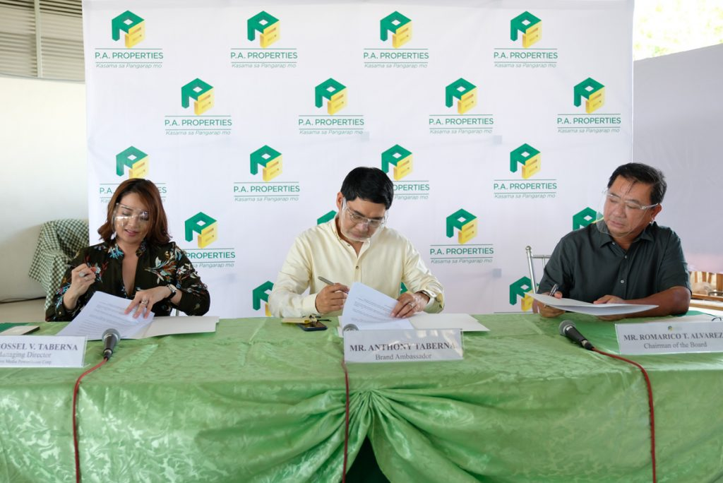 "Signing the contract (From left: Ms. Rossel Velasco- Taberna, wife and manager of Ka Tunying, Mr. Anthony ""Ka Tunying"" Taberna and Mr. Romarico ""Bing"" Alvarez, Chairman of P.A. Properties)"